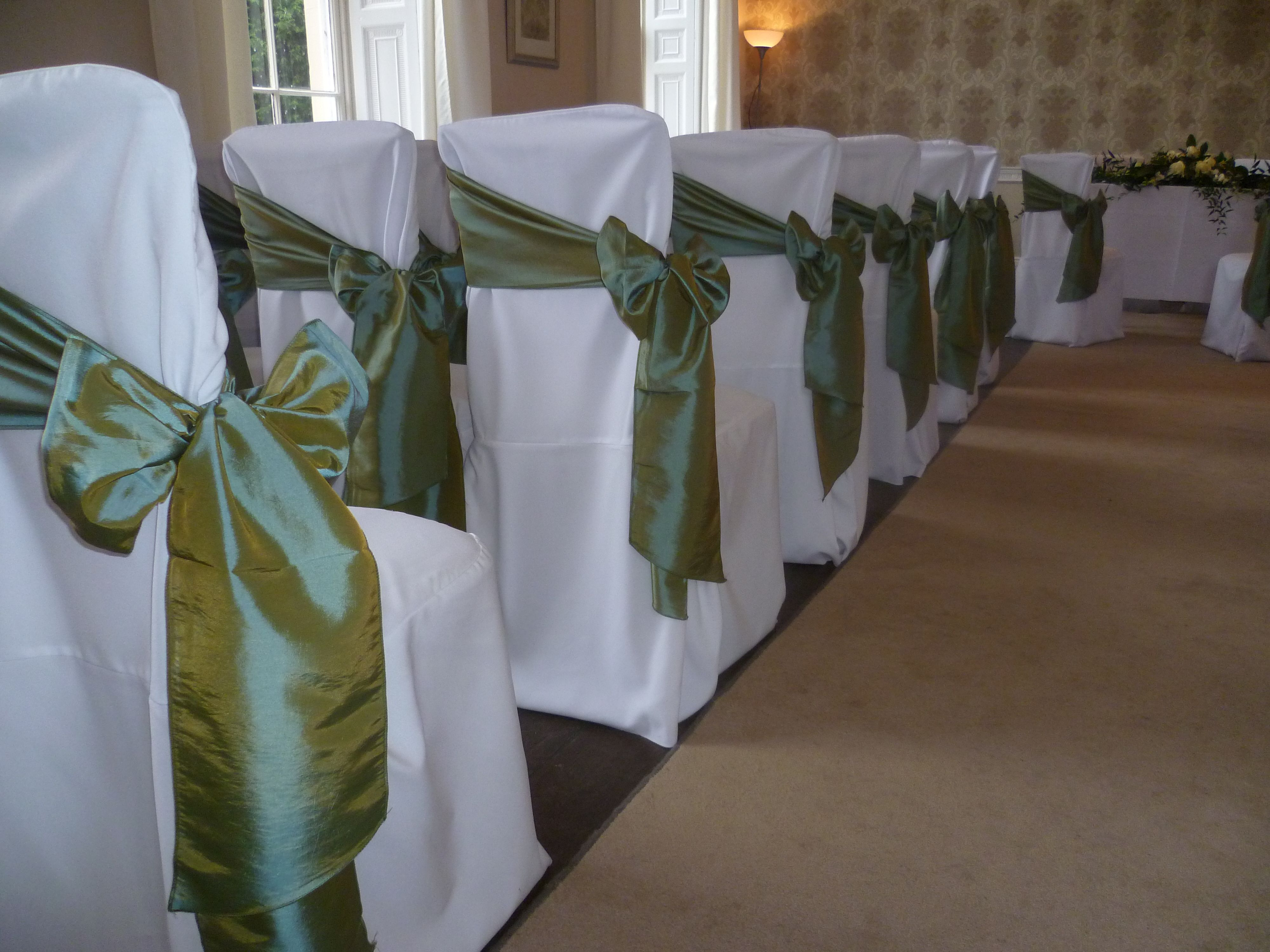 Wedding Venue Styling Chair Cover Hire Ambience Venue Styling Wedding Theme Colors Olive Green Weddings Wedding Chair Decorations