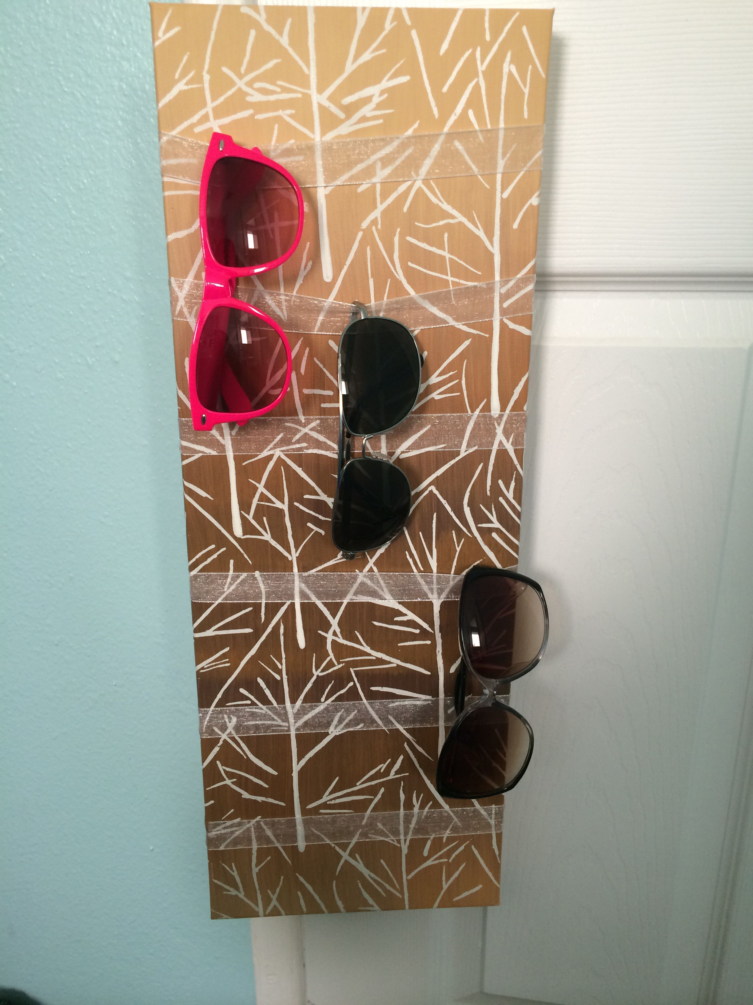 Sunglasses holder out of a canvas and ribbon.