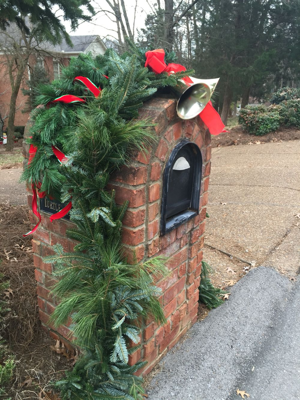 Another Great Idea For A Domed Brick Mailbox Love The Bells And Ribbon Mailbox Decor Christmas Mailbox Decorations Outdoor Christmas Decorations