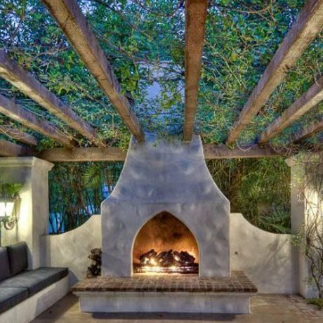 Outdoor room - wow.  Vine covered vigas with a fireplace and seating.  Wow.