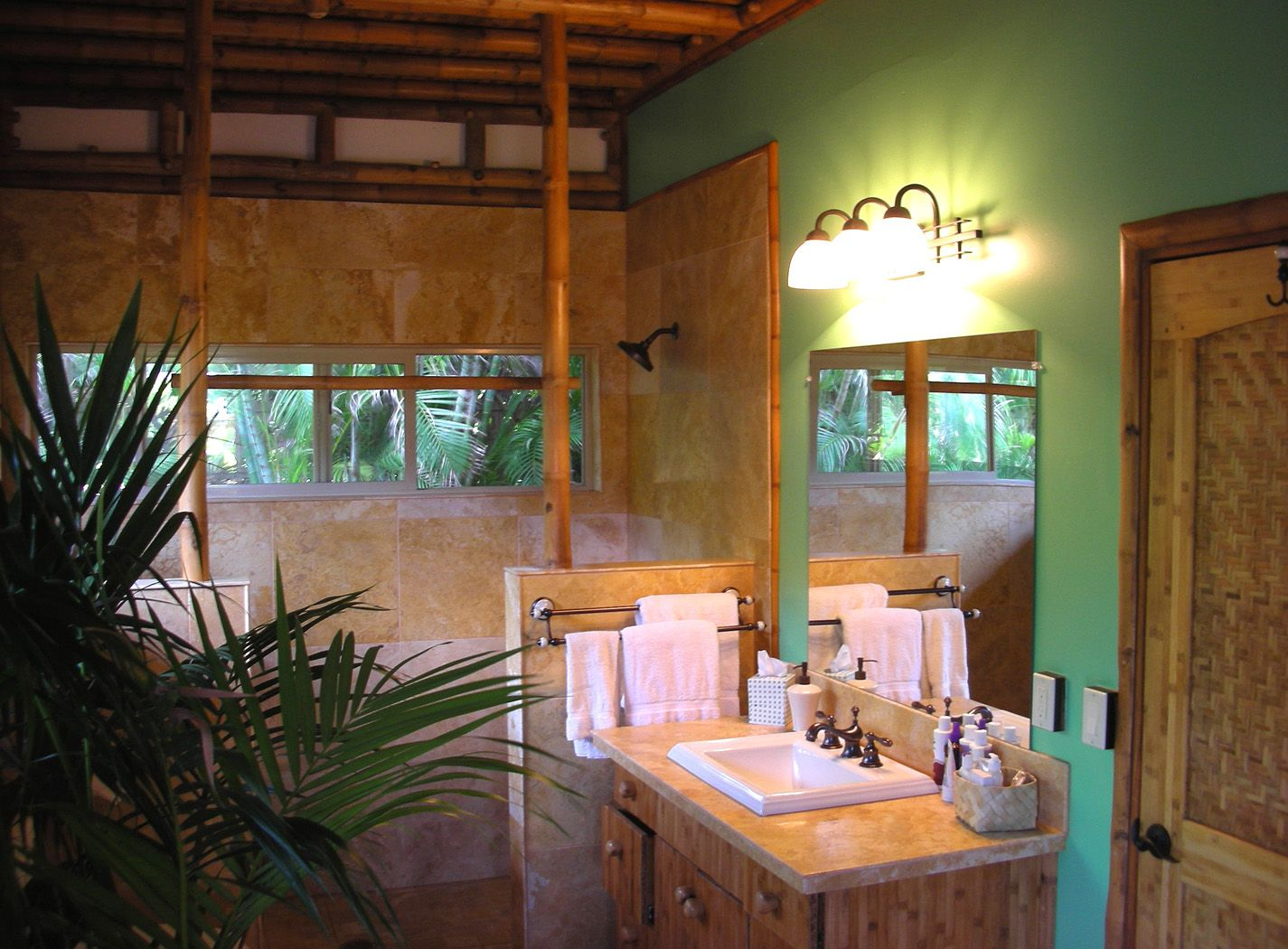 Bamboo furniture bathroom with modern sink and exotic flower