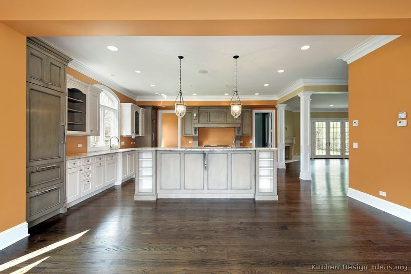 Orange Kitchen Walls With White Cabinets two toned kitchen |  of kitchens - traditional - two-tone