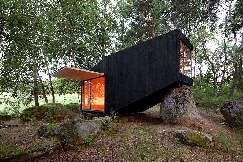 Uhlik Architekti balances private forest retreat on top of boulder #architecture #hideaway #stylepark