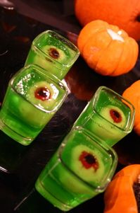 Eyeball Jello Shots -   (6 shooters)  1 pkg lime jello powder  6 canned or fresh lychees  6 maraschino cherries  6 slices of black grape  Stuff maraschino cherry into lychee w/o breaking it.  Cut slice from grape, place over red part of eyeball.  Prepare jello according to directions.  To suspend eyeball in jello, pour jello half way up in square shot glass, large enough to hold the lychee w/ room around edge, let set.  Place 'eyeball' on set jello, pour remaining jello into shot glass…
