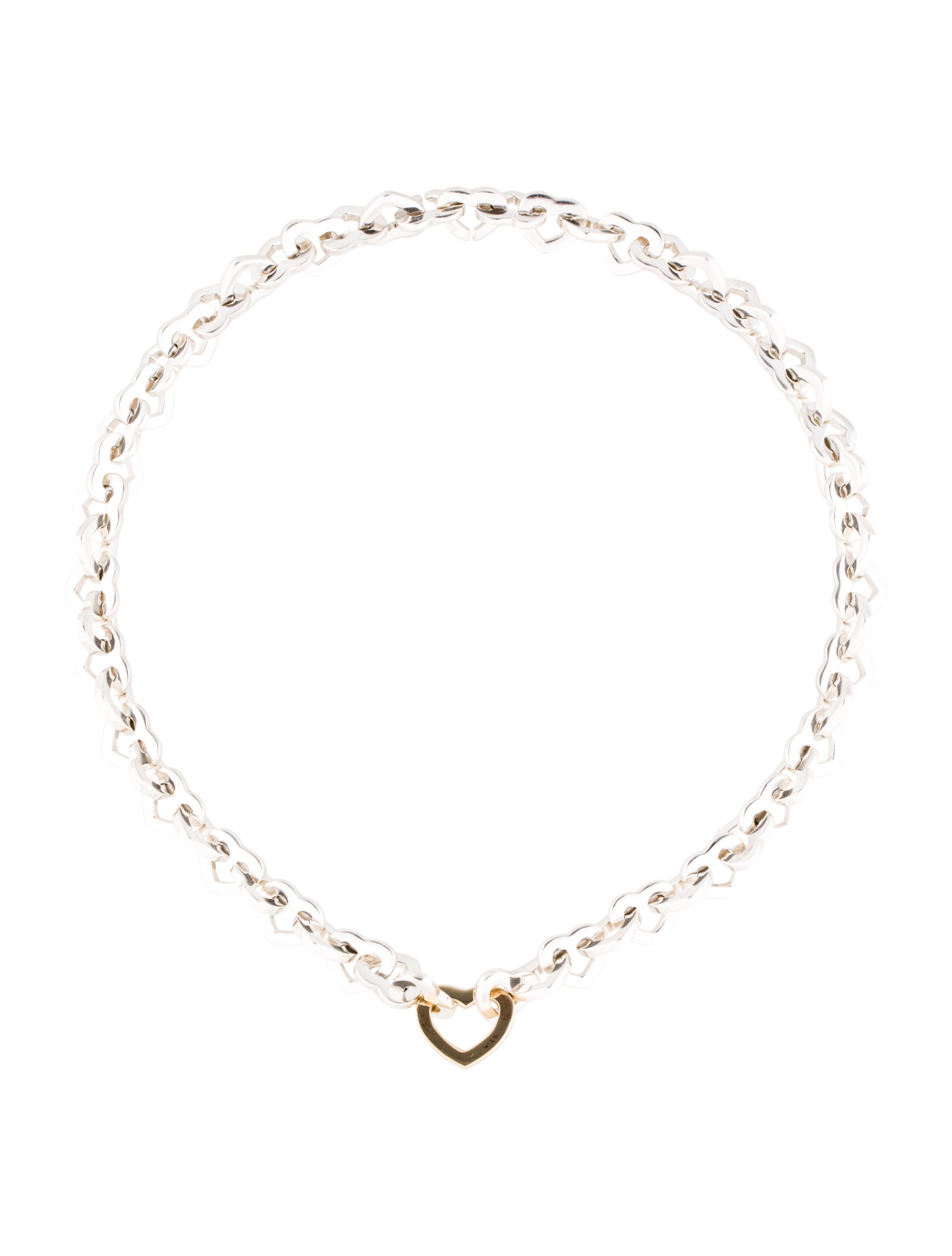564937636 Sterling silver Tiffany & Co. heart link necklace with 18K yellow gold  accent at center and invisibile clasp closure. Note: This item has been  appraised and ...