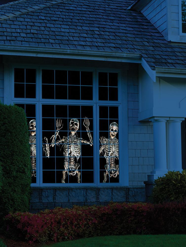 The Superior Holiday Scene Projector. This is the projector that displays animated, three-dimensional paranormal Halloween scenes out a window or on a wall. The included projector displays lifelike zombies, skeletons, and apparitions up to 6'-tall on the inside of a window, making trick-or-treaters think your home is being overrun by the paranormal.