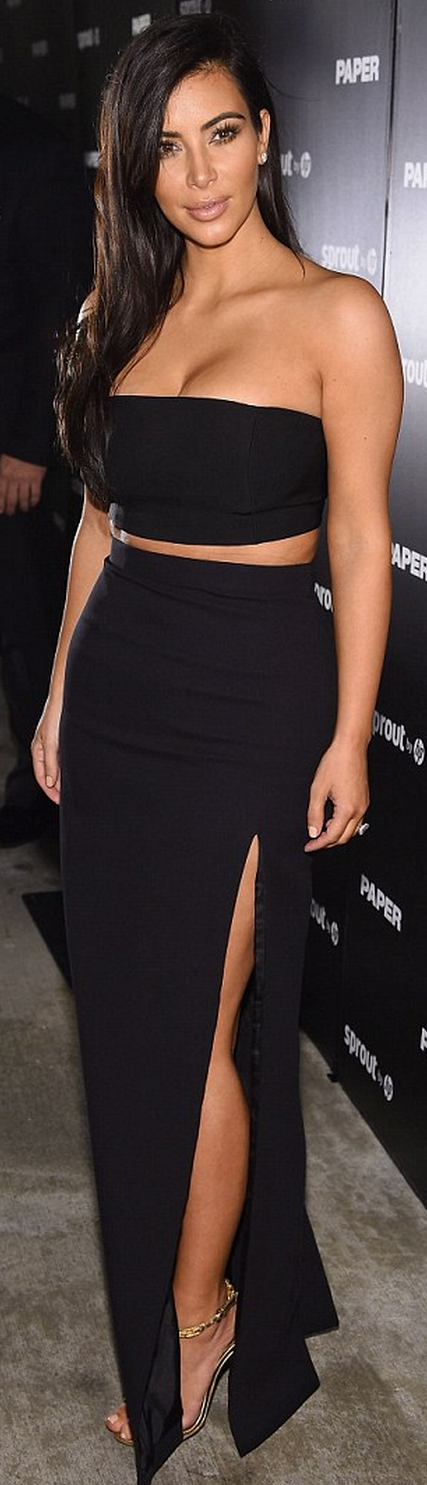 Who made  Kim Kardashian's gold chain sandals, black slit maxi skirt, and strapless top?