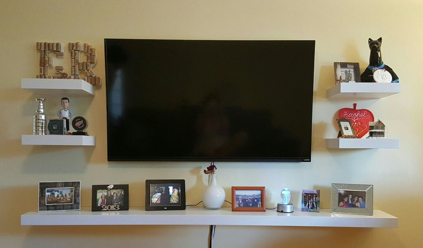 Living Room With Tv Mounted On Wall wall mounted tv decor! floating shelves make the entire wall a