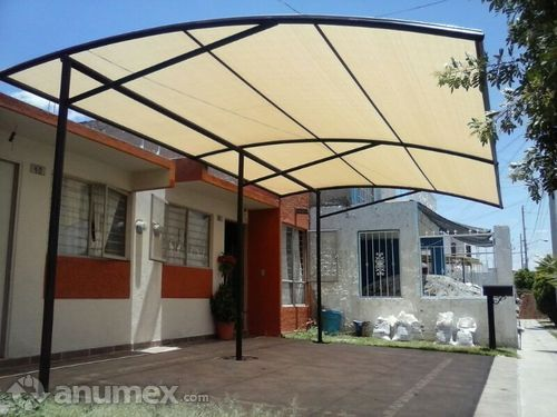 Toldos techos cubiertas en malla sombra y lona este es un for Toldos para patios