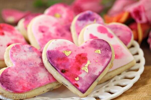 These Watercolor Rose Sugar Cookies are gorgeous and romantic, perfect for Valentine's Day! The cookies have real rose petals baked right in!