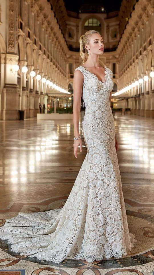 S In Des Moines Iowa Carries Eddy K Bridal Style Fl Lace Embellishes This V Neck Fit N Flare Gown Making It Perfect For A Garden Wedding
