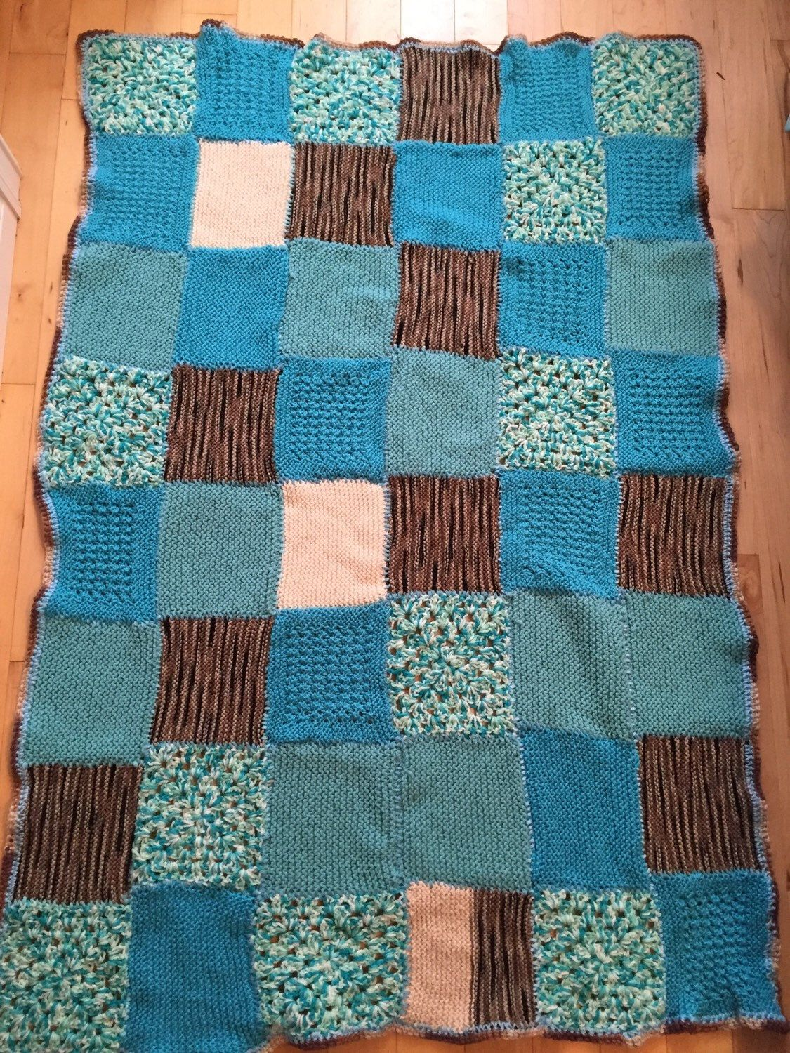 A personal favorite from my Etsy shop https://www.etsy.com/ca/listing/254020404/teal-crochet-throw-teal-cream-and-brown