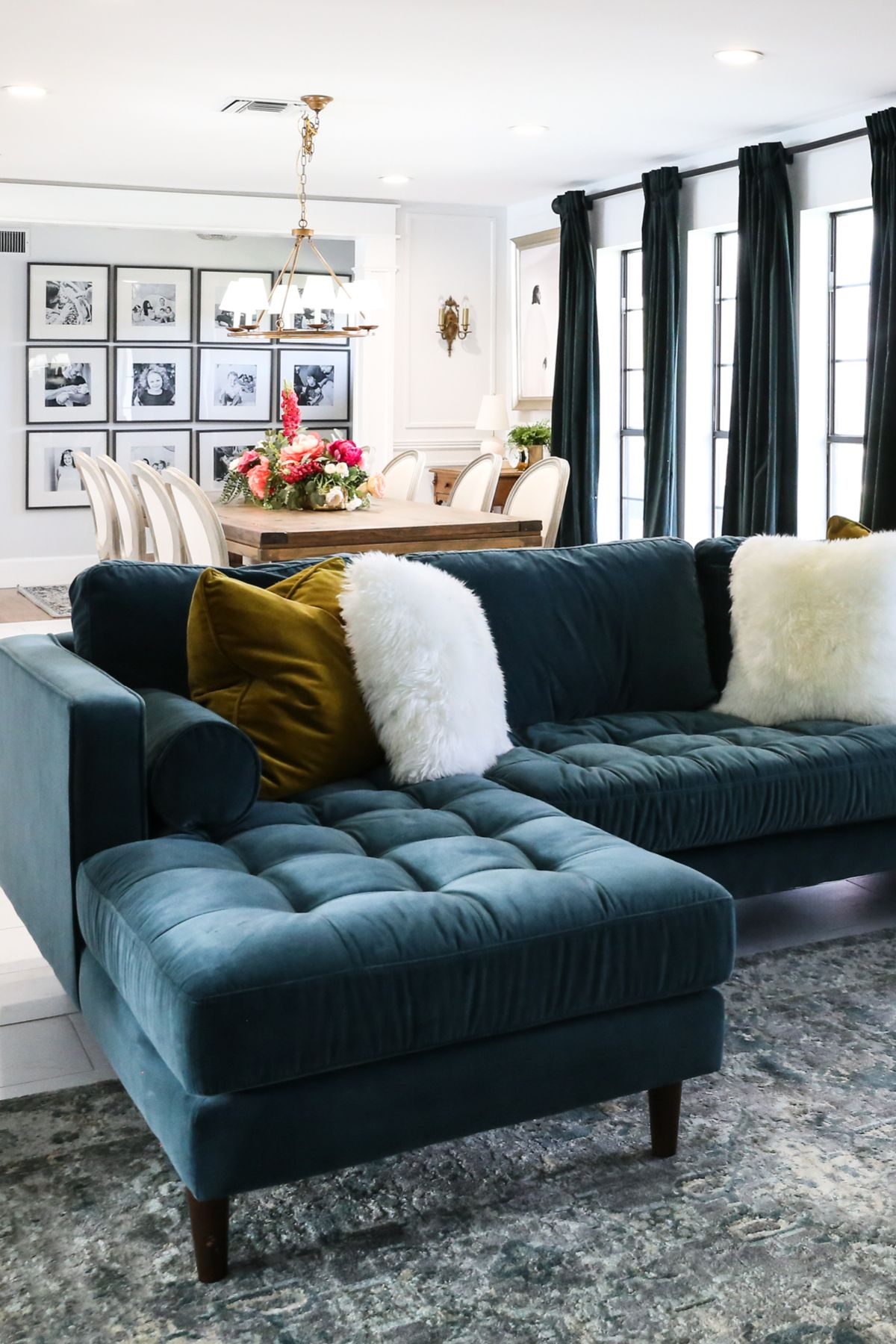 Deep as the sea. The Sven sectional features a chaise to lay yourself out on. Go on, lounge hard. Photo by Classy Clutter. #VelvetSofa #VelvetFurniture #LivingRoomIdeas #LivingRoomDesign