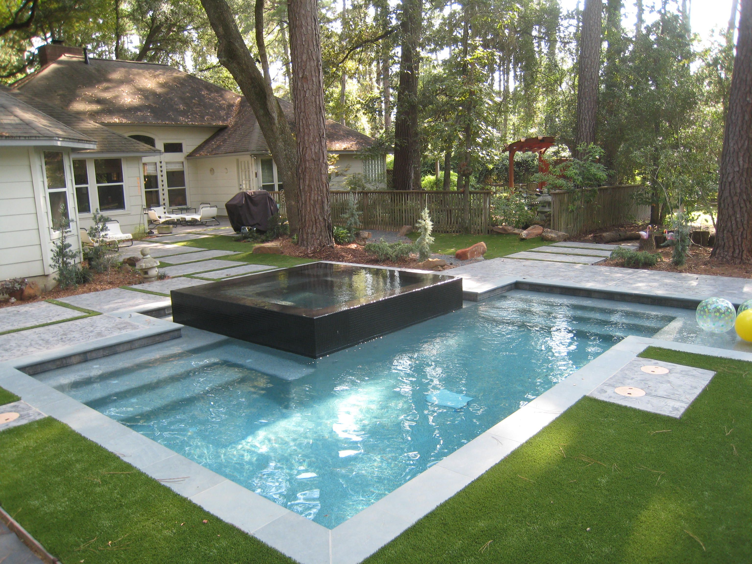 Raised spa with negative edge spill over custom swimming for Raised pool designs