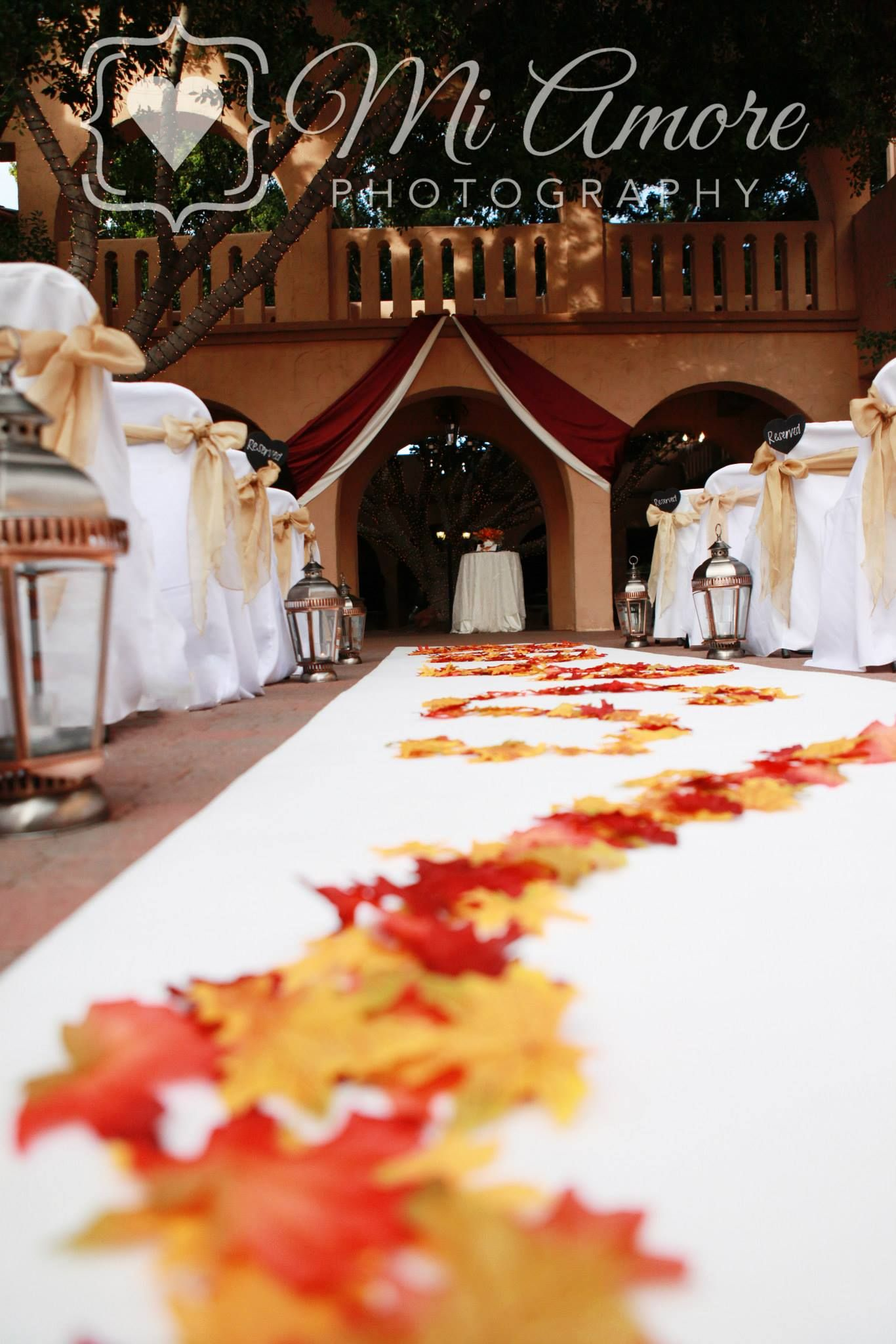 Fall ceremony set up at Aldea burgundy and white draping sheer