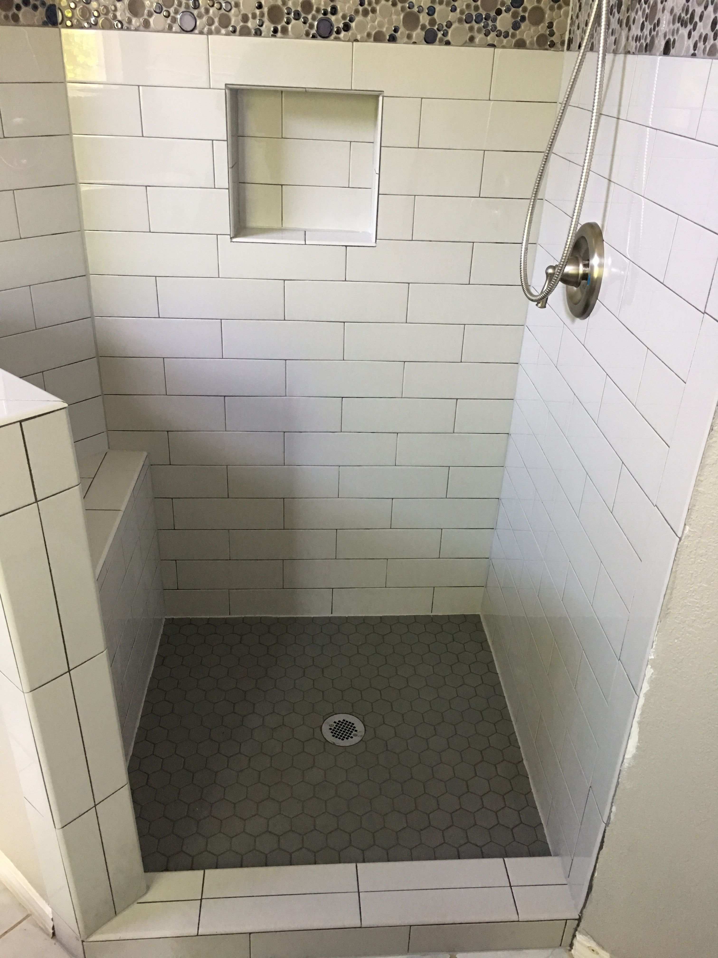 cool gray 4x16 subway tile shower with