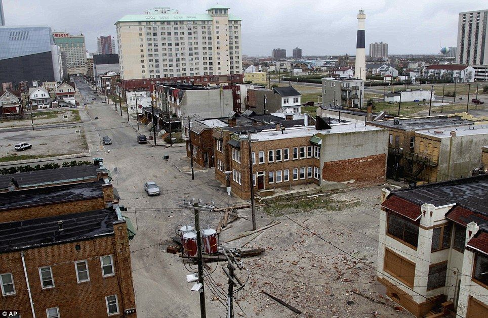 Extraordinary: Sand and debris covers the streets near the water in Atlantic  City, New