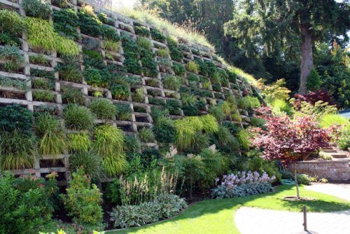 Vertical Garden Integrated With Concrete Crib Retaining Wall Landscaping Retaining Walls Sloped Garden Landscaping A Slope