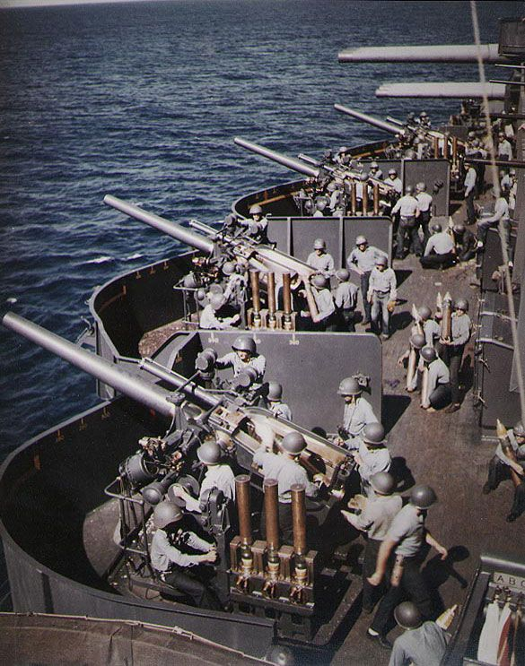 Battleship USS New Mexico's 5-inch guns prepared to bombard Saipan, 15 Jun 1944. (US National Archives)