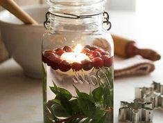 ▷ 1001+ Ideen für Weckgläser dekorieren zum Nachmachen #weckgläserdekorieren kleine Früchte - Einmachgläser Deko und grüne Zweige in der Küche #weckgläserdekorieren