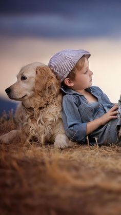 Photo of Serene picture of boy and dog.
