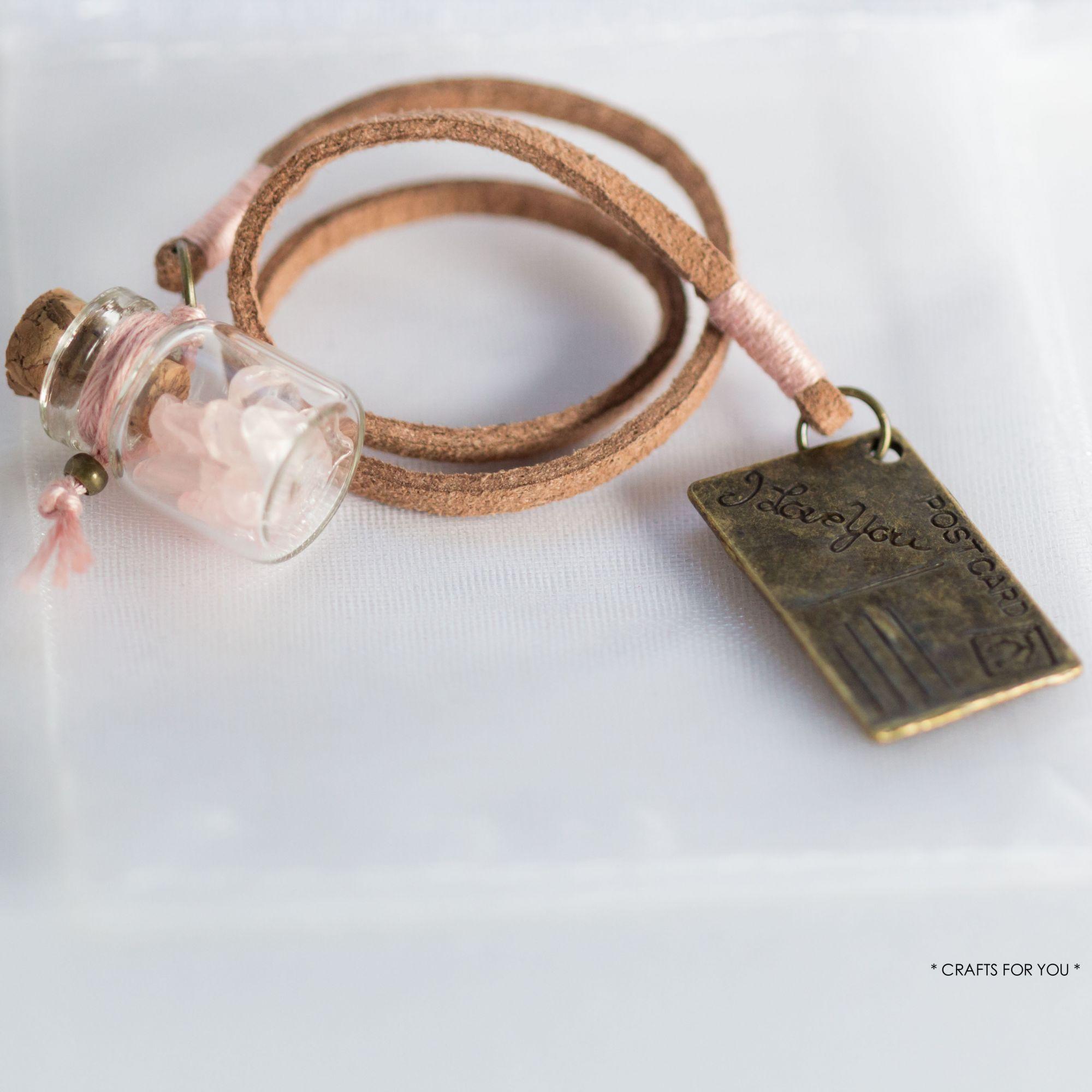 Mini-bottle with rose quartz chips & postcard-Status: available.