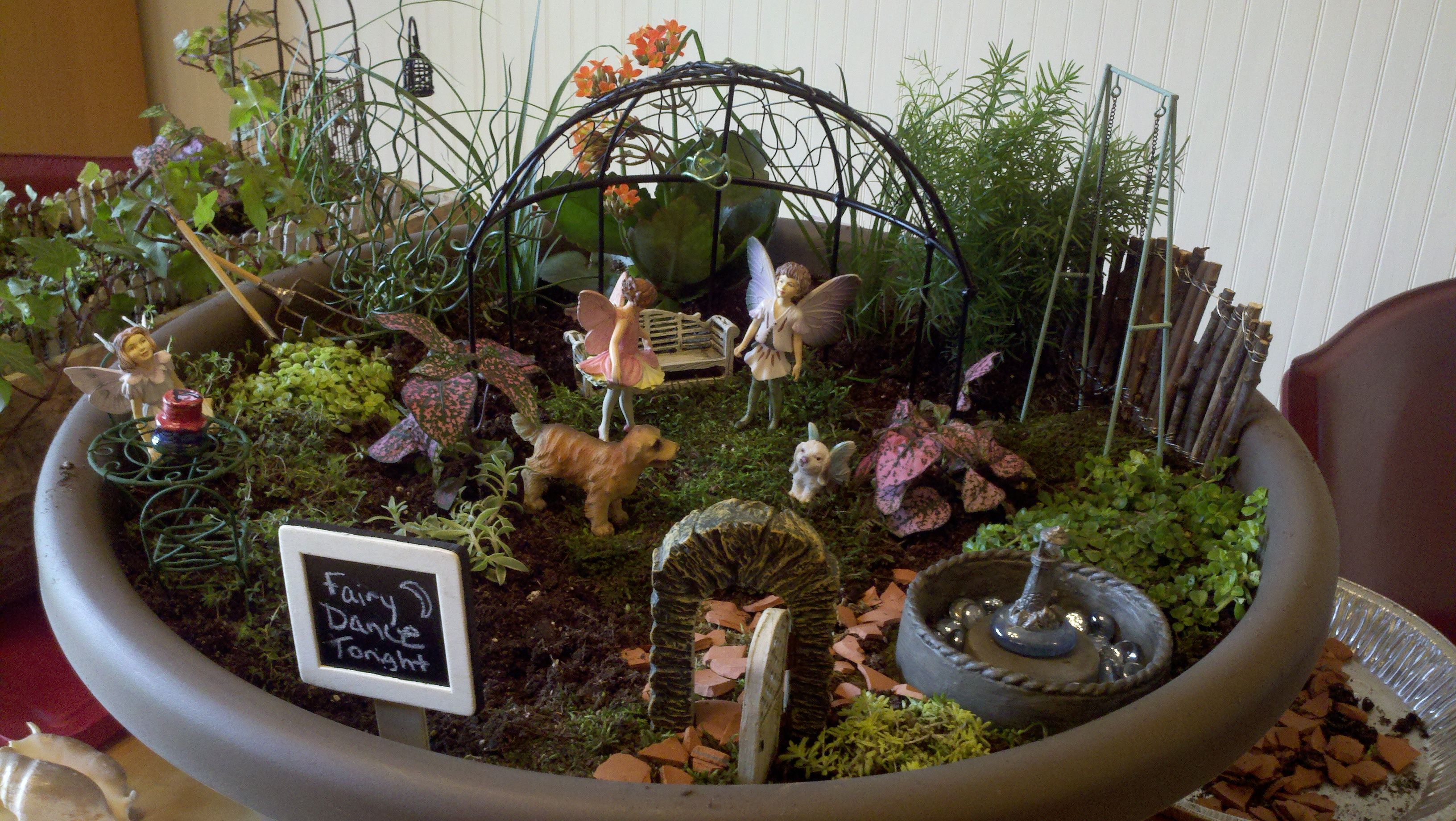 We had a rainy day and made this new Fairy Garden - lots of fun ...