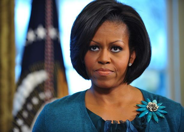 The First Lady has worn this Erickson Beamon brooch on several occasions, including back in 2010 at the oval office with a matching teal ensemble.