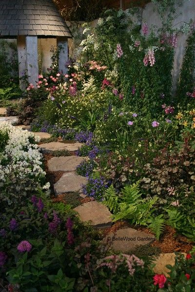 Photo of flagstone garden path..someday I would love our entire side yard to be like this…