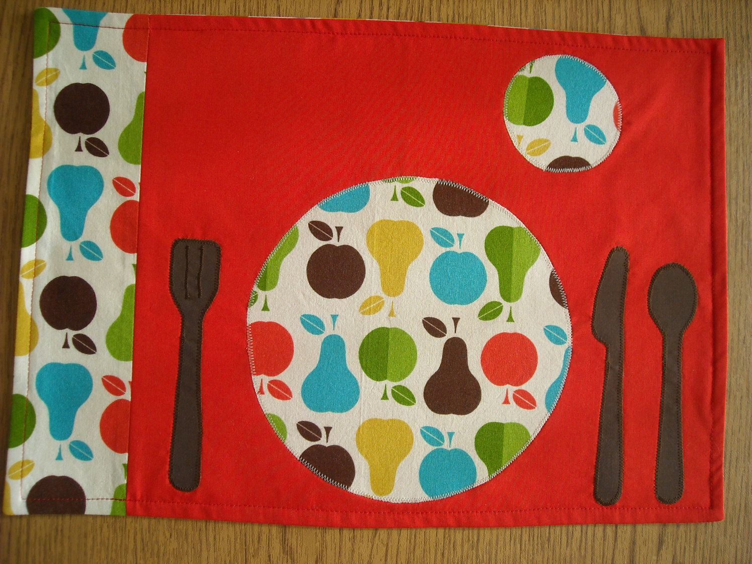 Love kids kitchen placemat with place setting of plate fork