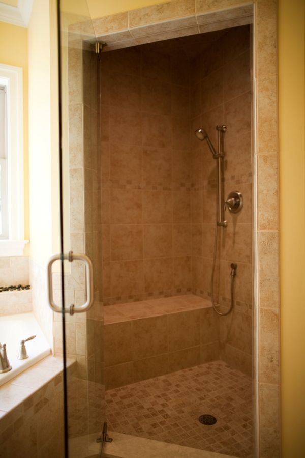 Walk-in tile shower with a built-in bench. | Bathrooms | Pinterest ...