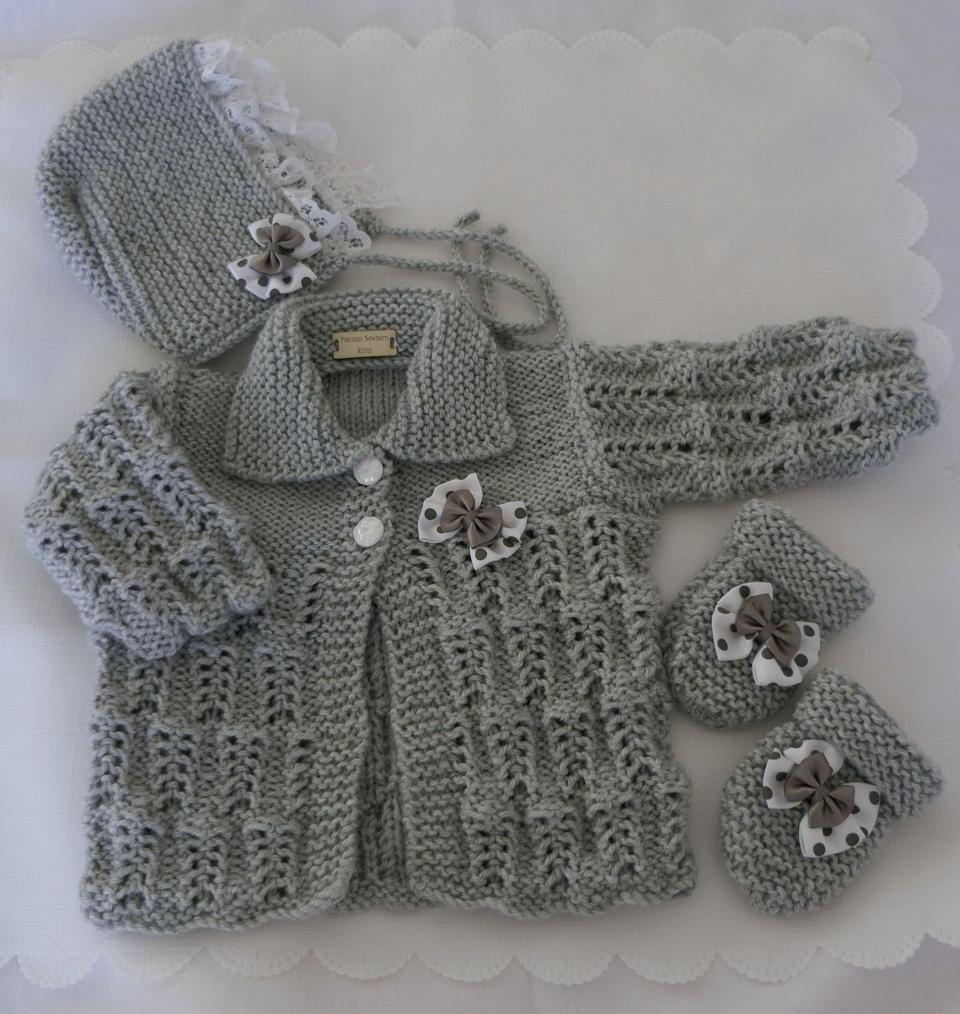 A BEAUTIFUL HAND KNITTED SET OF HAT,MITTS AND CARDIGAN FOR 0-3 MONTHS