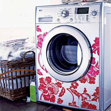 Use the silhouette cameo to cut vinyl stickers to spruce up a drab laundry room