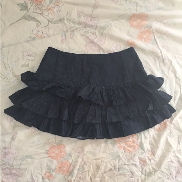 High waisted jeans skirt NWOT Adorable high waisted jeans skirt, three tiered ruffles and a zipper for for the back, never worn. They're  just too short for my taste. Forever 21 Skirts