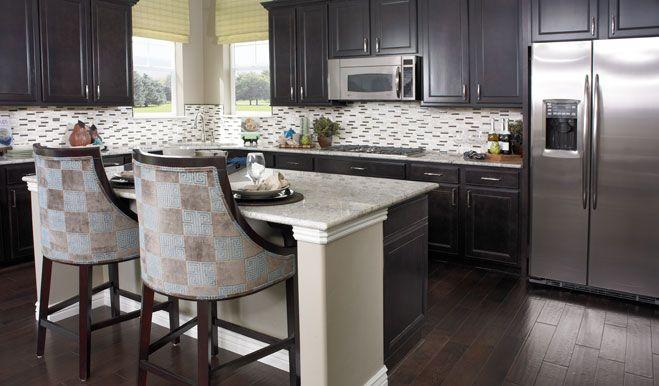 Dynamic Backsplash And Corner Windows Over The Kitchen