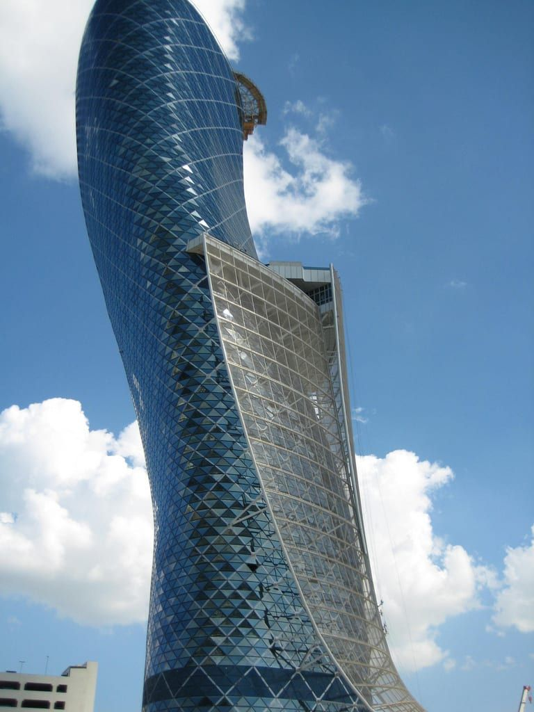 """One of the tallest buildings in the city, the Capital Gate has been certified by the Guinness Book of World Records as the """"world's furthest leaning man-made tower."""" The building leans 18 degrees, four times more than the Leaning Tower of Pisa.(Source: Quora)"""
