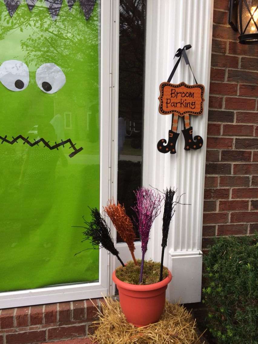 Brooms and sign from Hobby Lobby Easy door with green wrapping - Hobby Lobby Halloween Decorations
