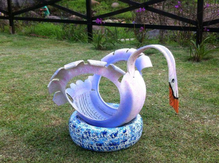 tire planters   swan tire planter