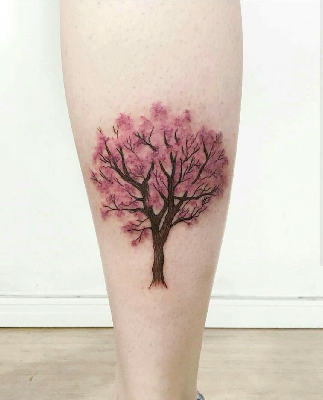 In Autumn Colors Or Shades Of Green Cherry Tree Tattoos Tree Tattoo Color Blossom Tattoo