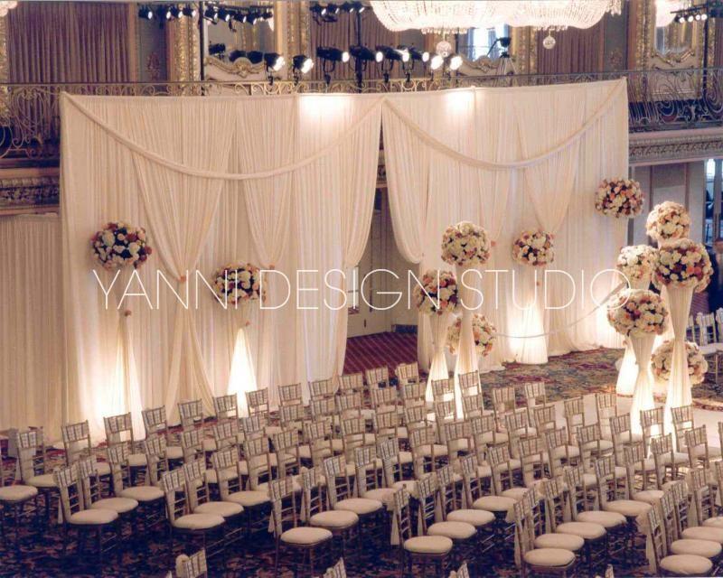 Elegant Drapery At Indoor Ceremony: Elegant Ivory Drapes With White LED Back-lighting
