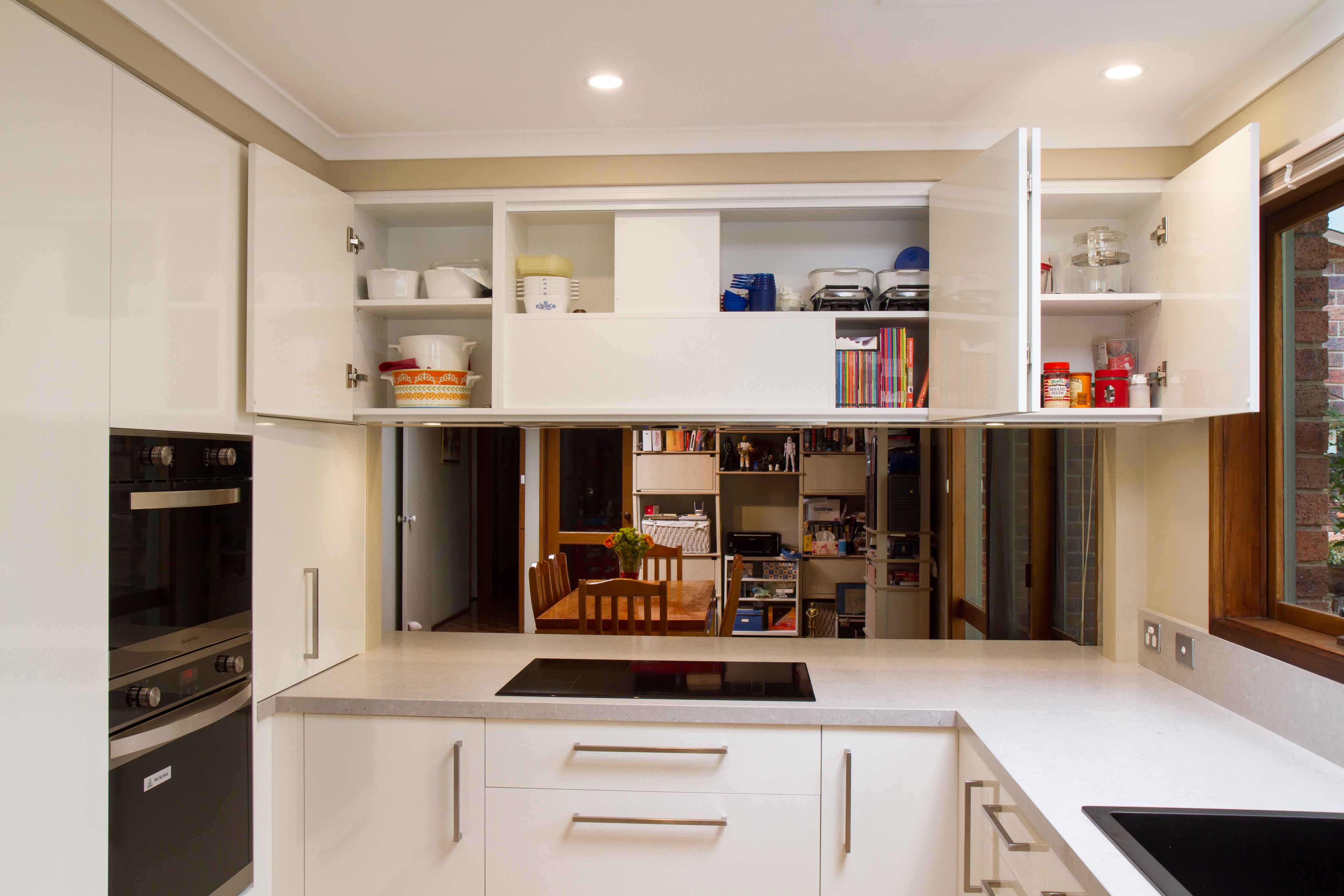 Contemporary kitchen with large servery into the dining