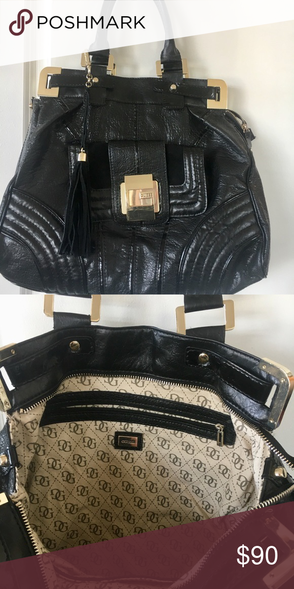 acd3dd996ab Beautiful Black Guess Purse Gently used, authentic Guess purse Large bag  Leather material on outside Monogrammed detail on interior Guess Bags  Shoulder Bags