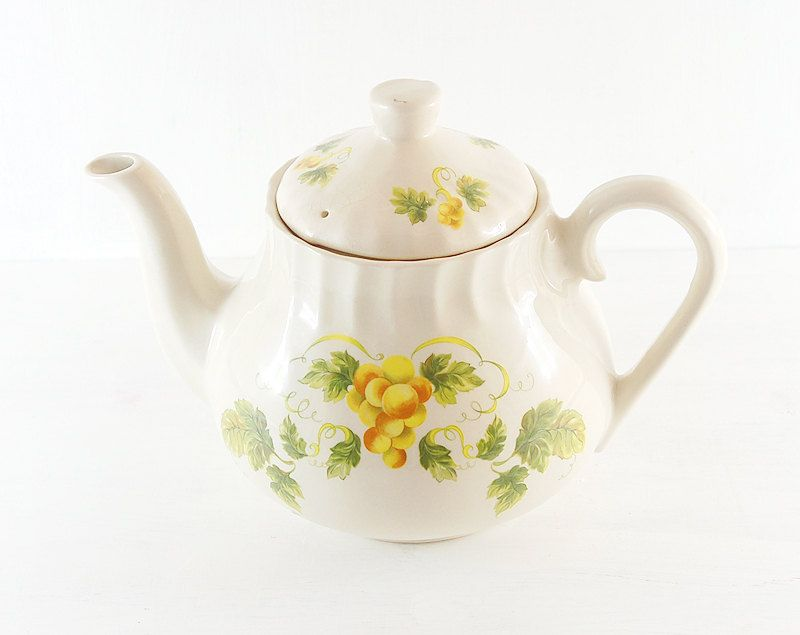Vintage tea pot in yellow and white floral pattern. Feminine country style. shabby chic chintz. yellow tea party. $10.00, via Etsy.