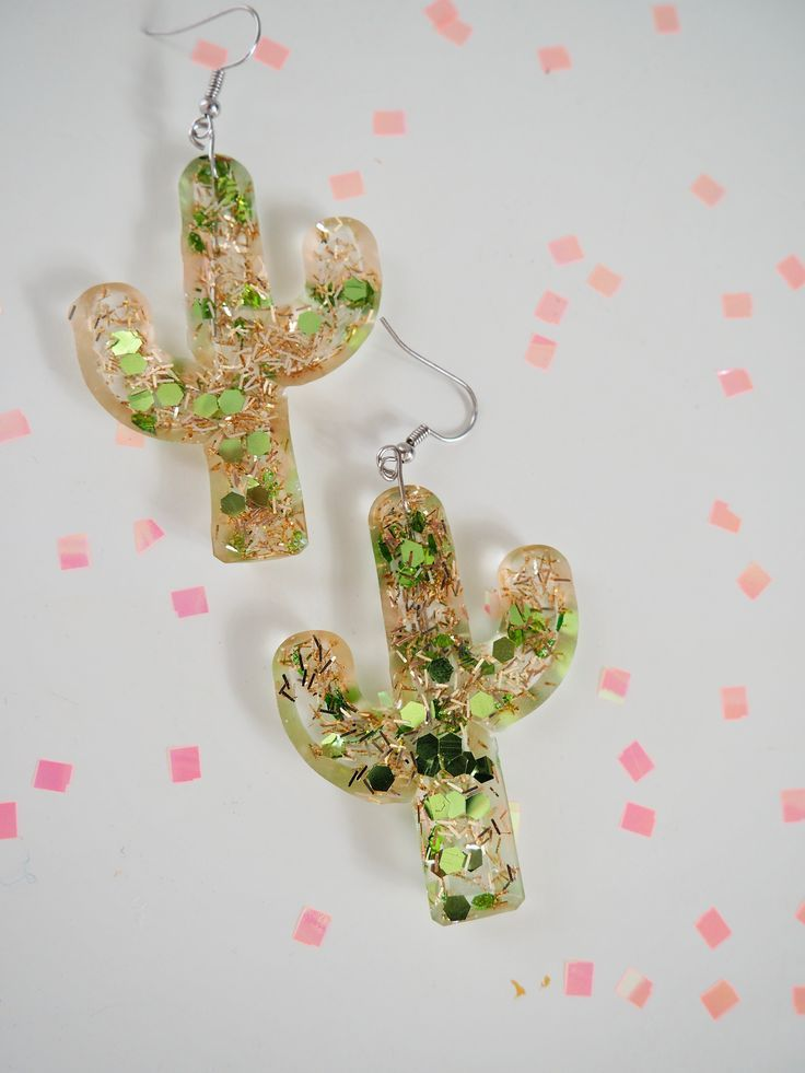 Resin Cactus Earrings With Gold and Glitter is part of Diy resin earrings, Resin jewelry diy, Cactus earrings, Diy resin keychain, Resin charms, Resin jewelry - Learn how to make these colorful and glittery resin cactus earrings over on my blog! They are simple to make and create a big statement!