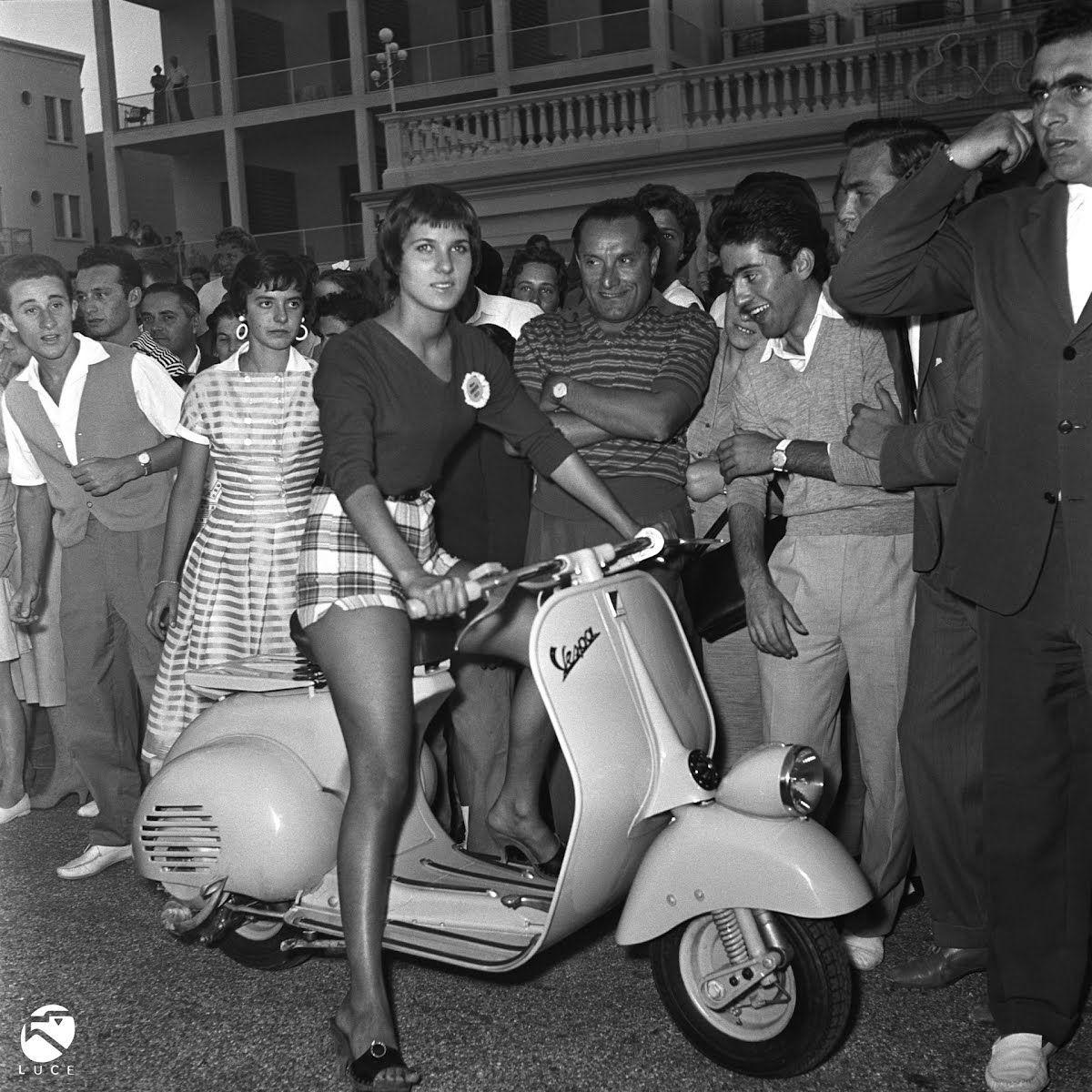 Anna Tonella Autori modelling for the Vespa competition in the streets of Rimini, Italy, 1963