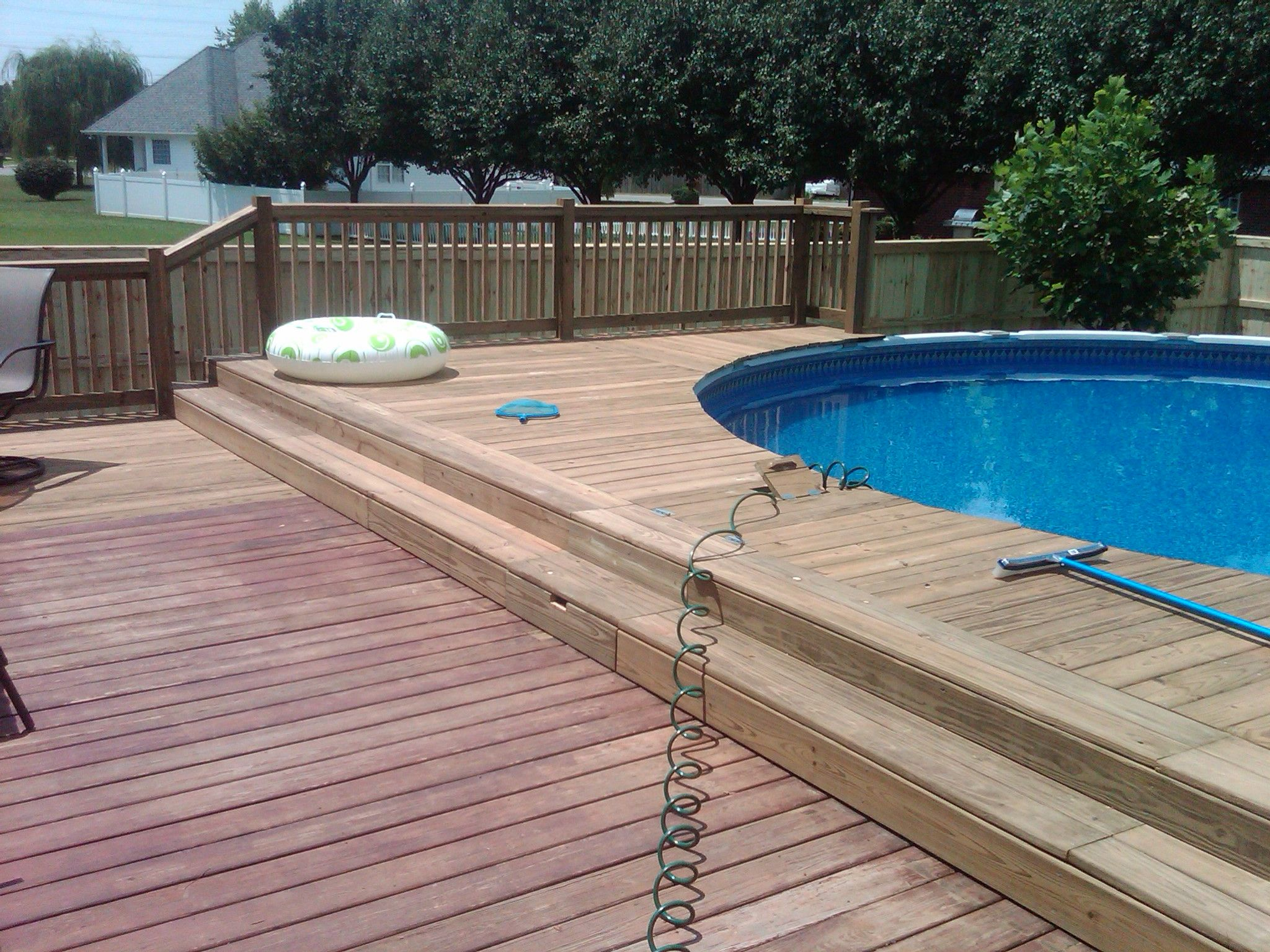 Modest wood pool deck in splendor house pertaining to for Deck from house to above ground pool