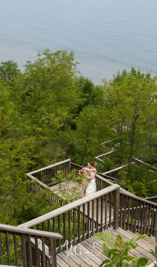 Best Wisconsin wedding photos of 2014 - bride & groom on stairs overlooking Lake Michigan (Port Washington, WI). Photo by MiaS Photo.