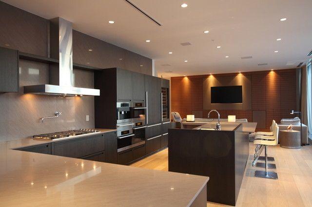 Robert Bailey Interiors modern family room featuring Dasal lighting fixtures
