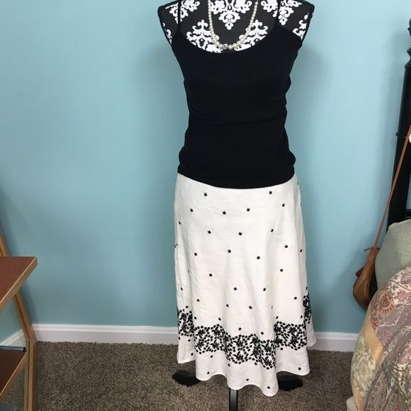 "Ivory and black skirt Looks like linen buts it's rayon. 25"" long 6P  has embroidered pattern across bottom. Fully lined Skirts Midi"