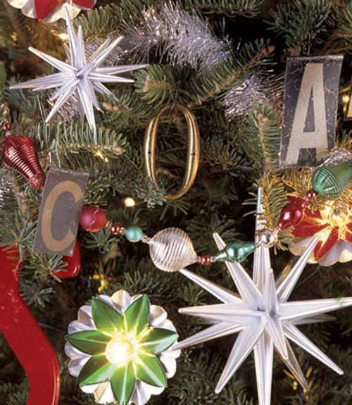 A tree is trimmed with vintage letters found from old signs, printers' type, and alphabet teaching aids.   - CountryLiving.com